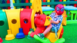 Little Boy SpiderMan Playing on the Playground