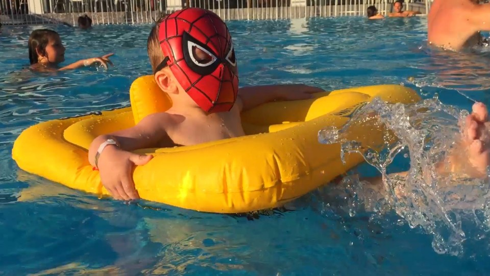 Little Boy SpiderMan having Fun in the Pool