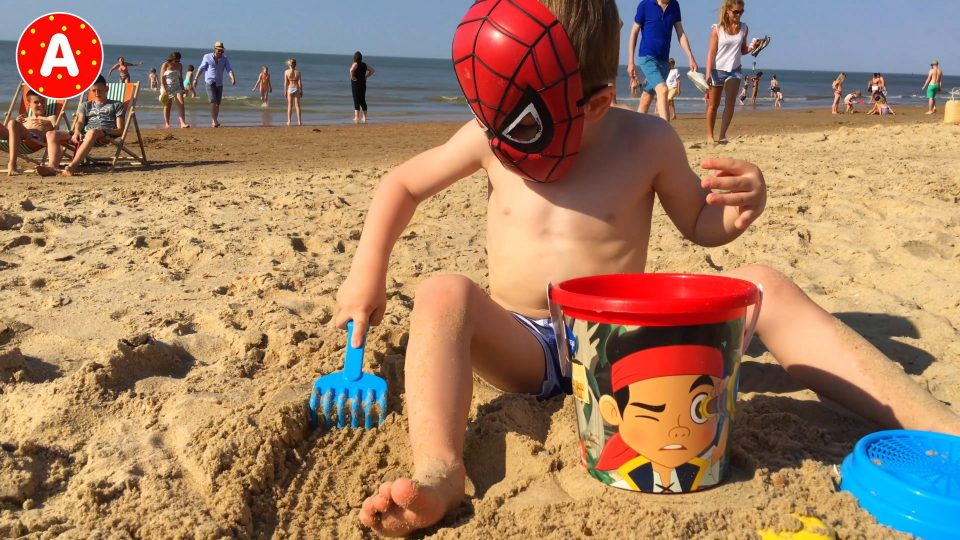 Boy Spider-Man LittleBoy Adam Unpacking Sand Toys on the Beach