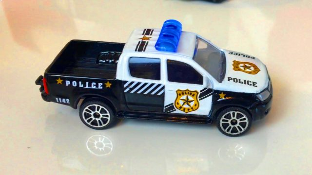 Little Boy Unpacking Police Transport Toys for Kids