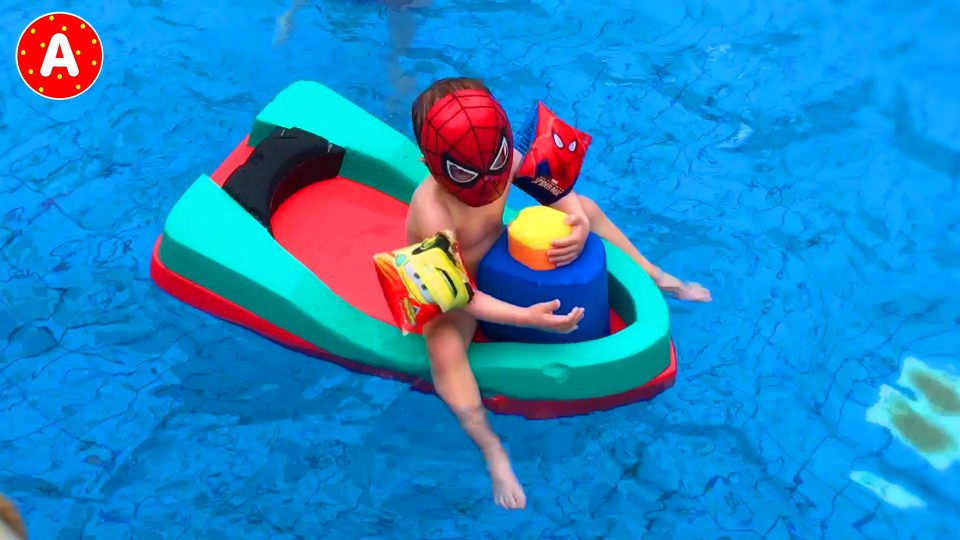Little Spider-Man driving his Lightning McQueen Car to the Aquapark