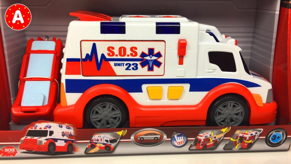 Adam Playing with Ambulance Toy Car