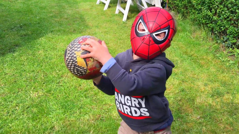 Spider-Man LittleBoy Adam playing with a Ball