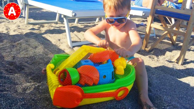 Adam Opening Toys Ship On The Beach Italy
