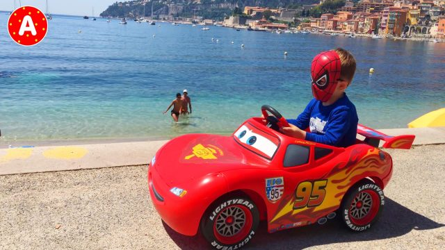 Little Boy Spider-Man Adam on the Beach in Nice France and his Car Lightning McQueen