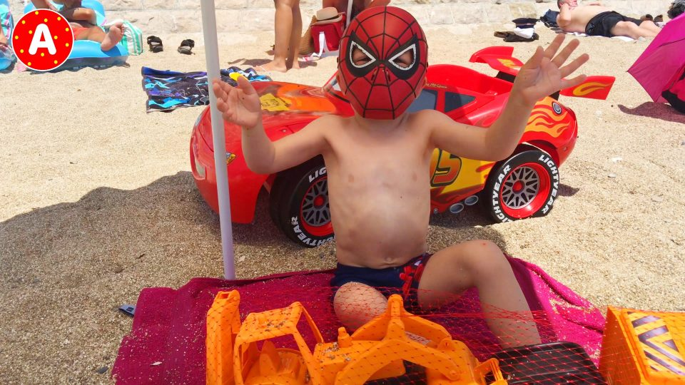 Spider-Man LittleBoy Adam Opening Cars Toys on the Beach in Nice France