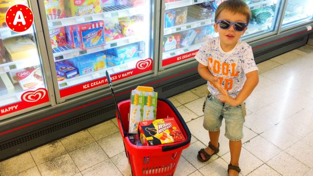 Little Boy Adam Buying An Ice-Cream In The Store