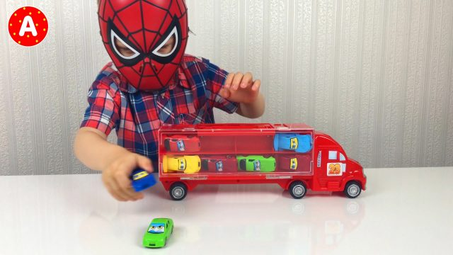 Little Boy Spider-Man Opening and Playing With Cars