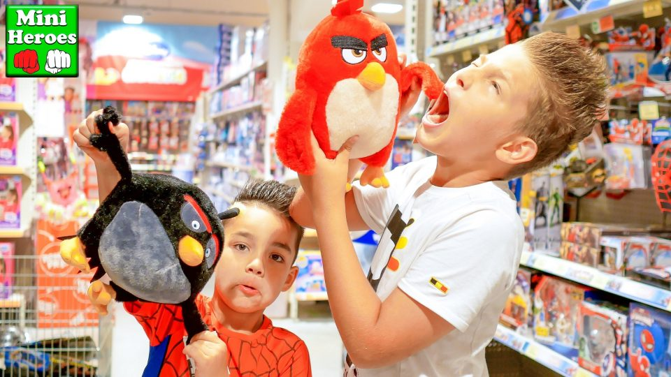 Spider Man in a toy story playing with Angry Birds