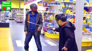 Spiderman vs Hulk.  Sword battle in a Children's toys store