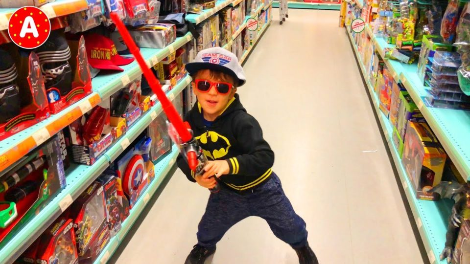Superhero Batman Having Fun in Médiacité Shopping Center and Playing with Toys in Toy Store